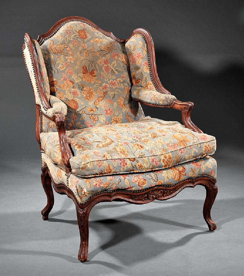 Carved Walnut and Needlepoint Fauteuil à Oreilles