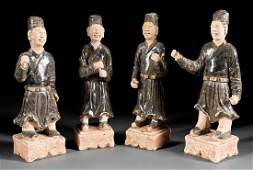 Group of Four Chinese Glazed Pottery Attendants