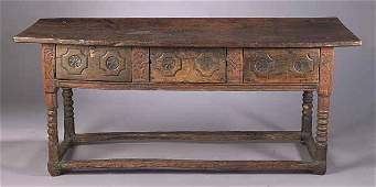 0526 A Continental Baroque Carved Walnut Re
