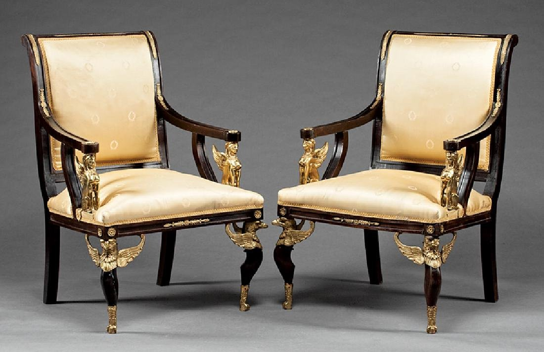 Carved and Gilt Bronze-Mounted Mahogany Fauteuils