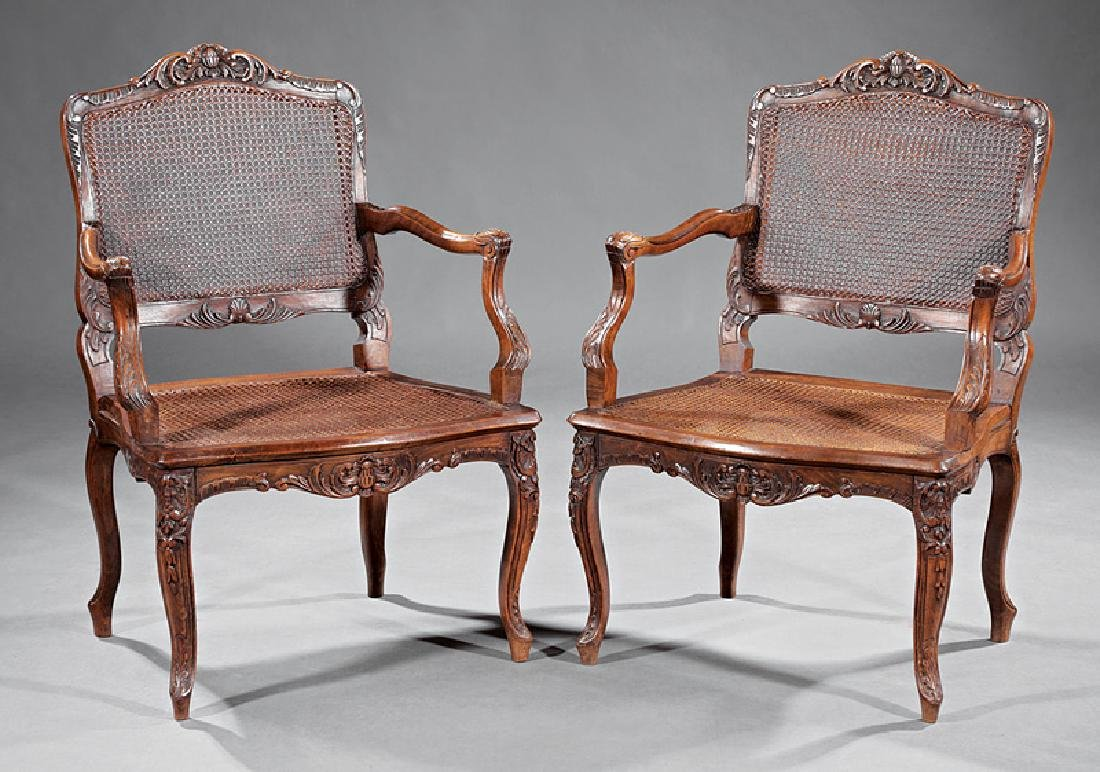 Louis XV-Style Carved Walnut Fauteuils
