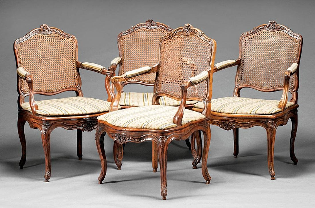 Eight French Provincial Carved Mahogany Fautueils
