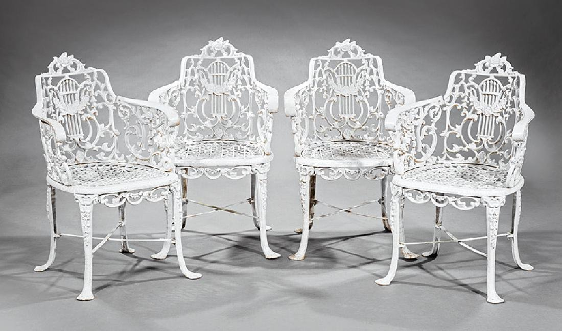 Four Painted Cast Iron Garden Armchairs