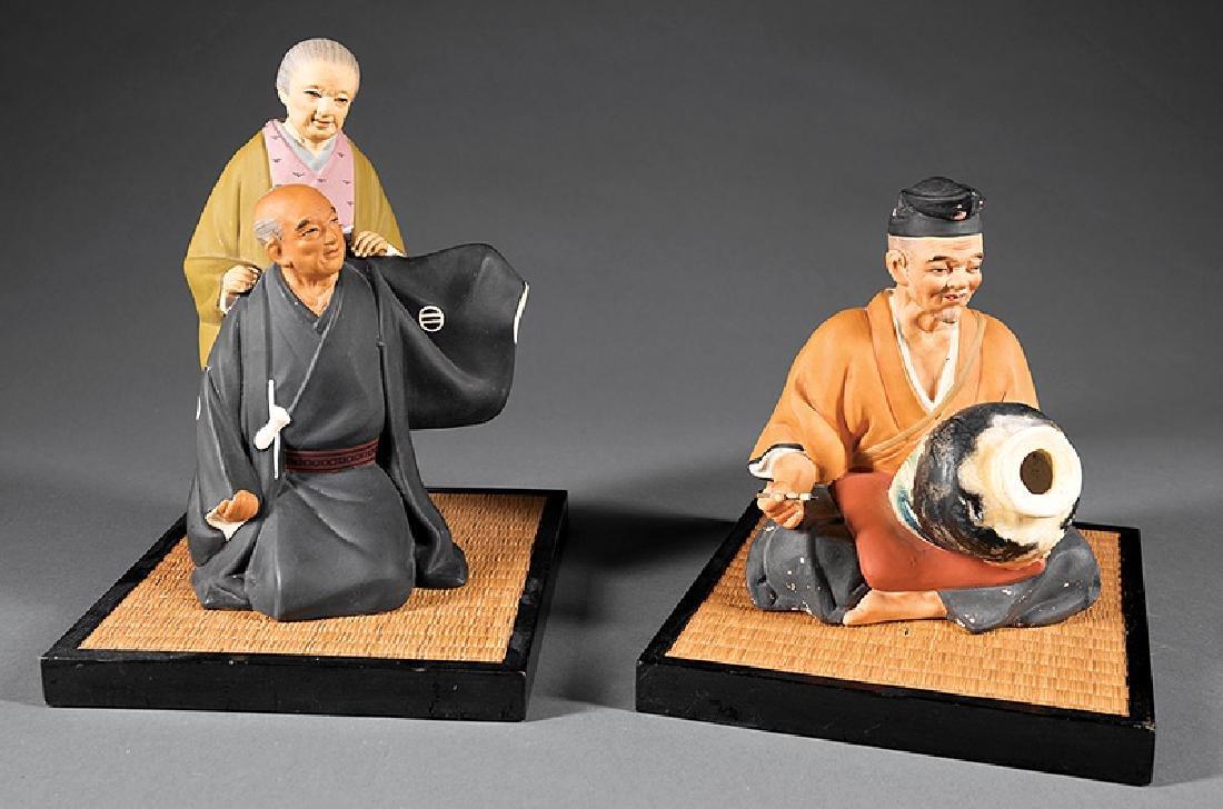 "Two Japanese Polychrome Pottery ""Hasaka"" Dolls"