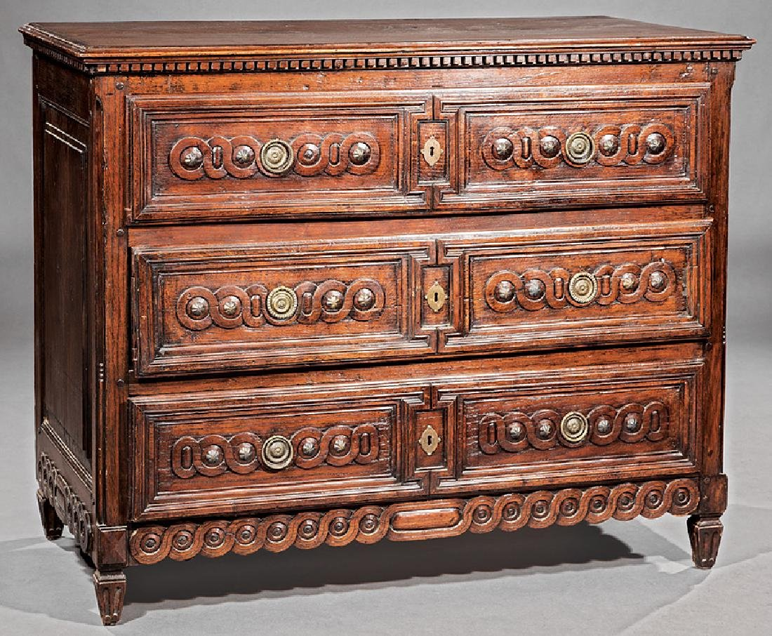 Louis XVI Carved and Brass-Mounted Oak Commode