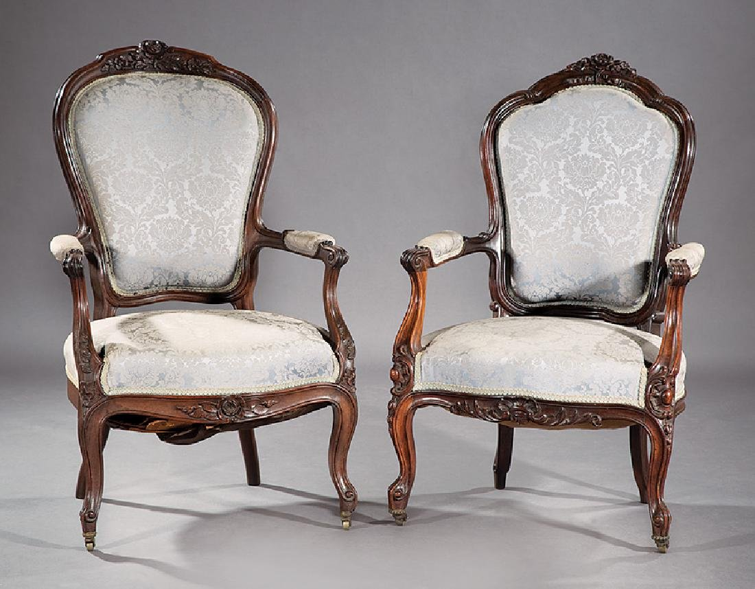 Two Louis XV-Style Carved Walnut Fauteuils