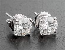 Pair of 18 kt. White Gold and Diamond Stud Earrings