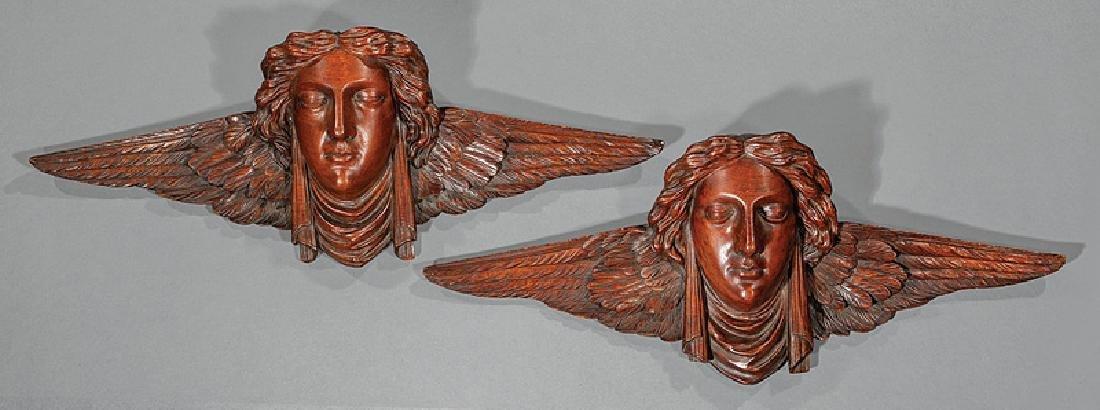 Carved Walnut Winged Heads attr. Gustave Herter