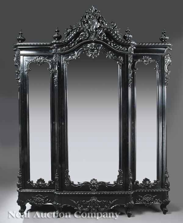 0635: Rococo Revival Carved and Ebonized Armoire