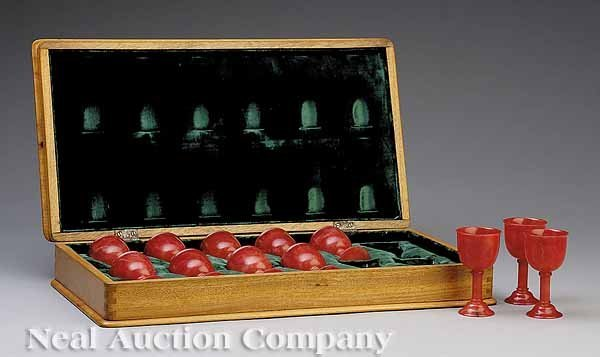0014: Twelve Red Carved Stone Stemmed Cordials