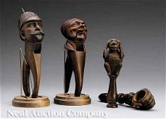 0634: Group of Four Carved Walnut Figural Nut Crackers