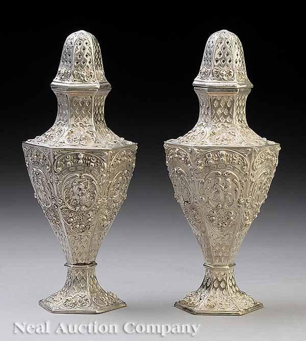0667: Pair of Continental Silver Repoussé Casters