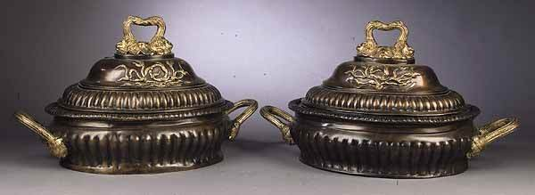 0808: A Pair of Oval Patinated and Gilt Bron