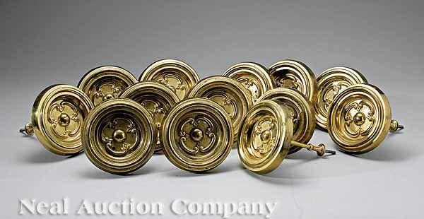 10: Thirteen American Gilt, Pressed Brass Tiebacks