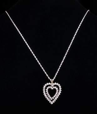 14 kt White Gold and Diamond Heart Pendant