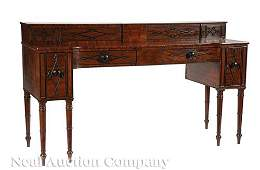 Carved and Parcel Ebonized Mahogany Sideboard