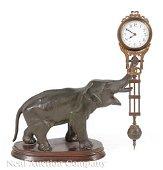 Patinated Metal Figural Swinging Clock