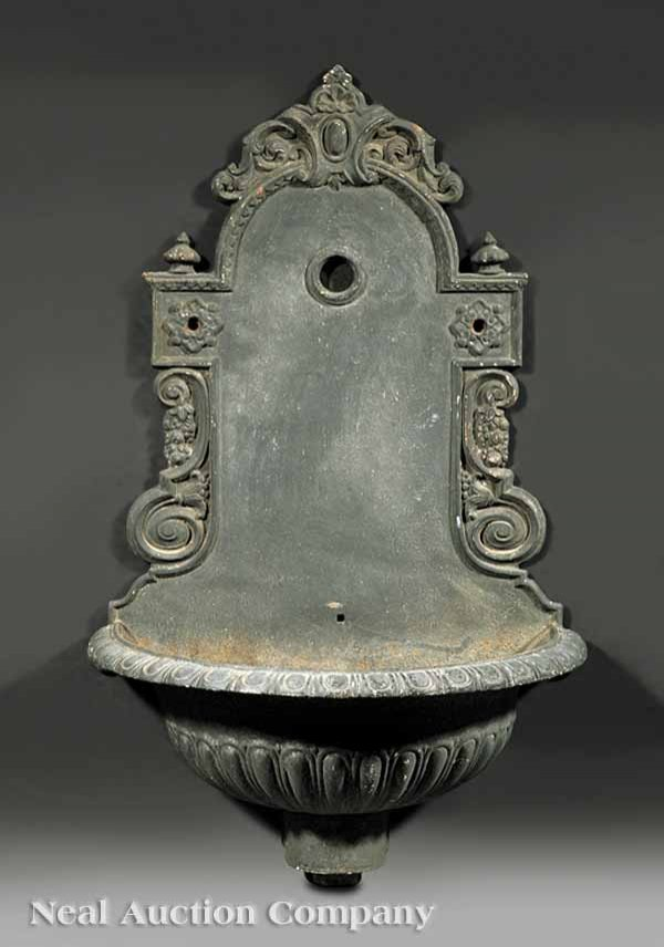 1007: An Antique Continental Cast Iron Wall Fountain