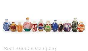Twelve Chinese Color Overlay Glass Snuff Bottles