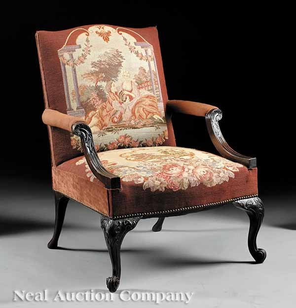 0671: Carved Mahogany and Needlepoint Library Chair