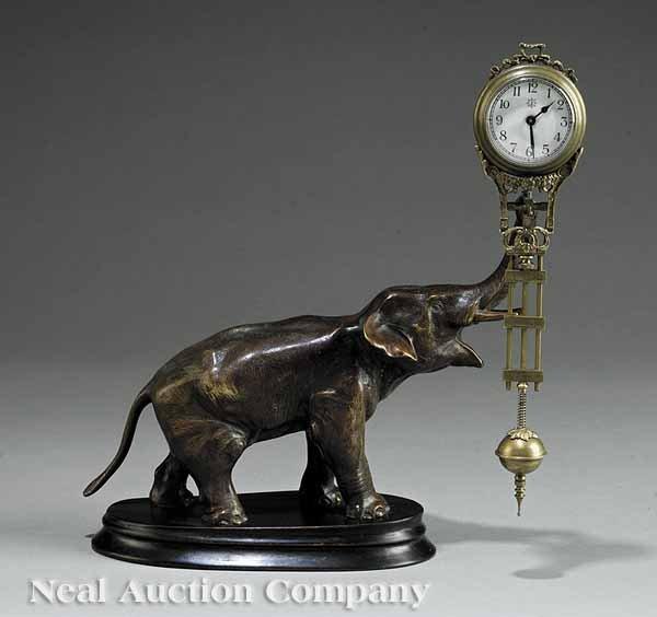0651: Bronze Figural Swinging Clock