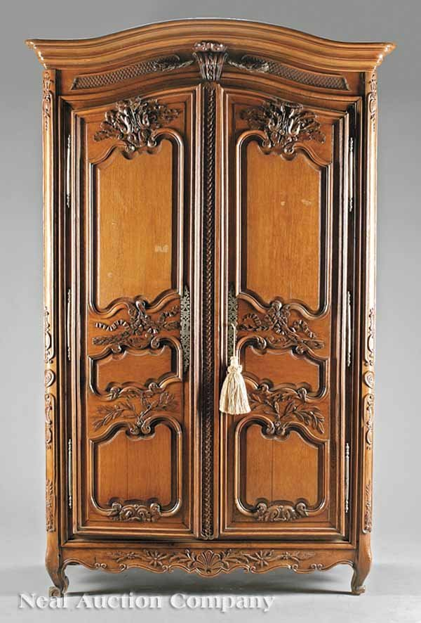 0664: French Provincial Carved Oak Armoire