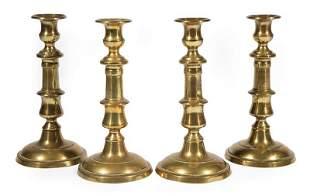 Four English Brass Baluster-Form Candlesticks