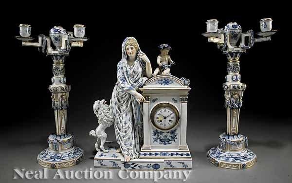 0738: A Meissen Blue, White and Gilt Clock Garniture