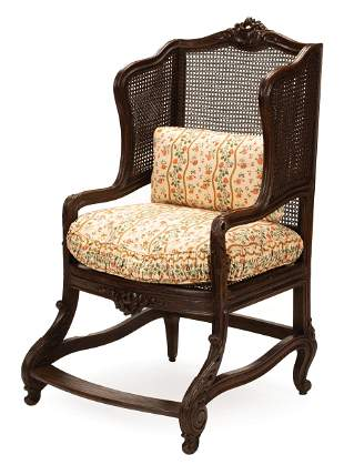 Carved Walnut and Caned Bergere a Oreilles