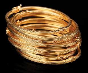 Ten Italian Gold Hinged Bangle Bracelets