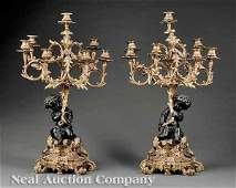 0562 Pair Gilt and Patinated Bronze Figural Candelabra