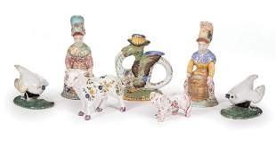 Seven Continental Faience Figurines