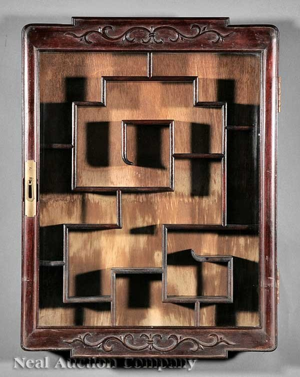 1039: A Chinese Carved Hardwood Hanging Display Cabinet