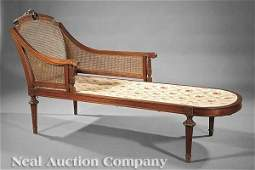 0749 Carved Walnut and Caned Chaise Longue