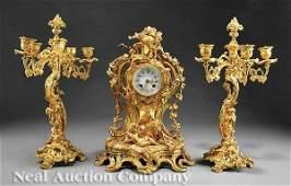 1124: An French Gilt Bronze Three-Piece Clock Garniture