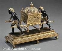 0011 Gilt and Patinated Bronze Figural Encrier