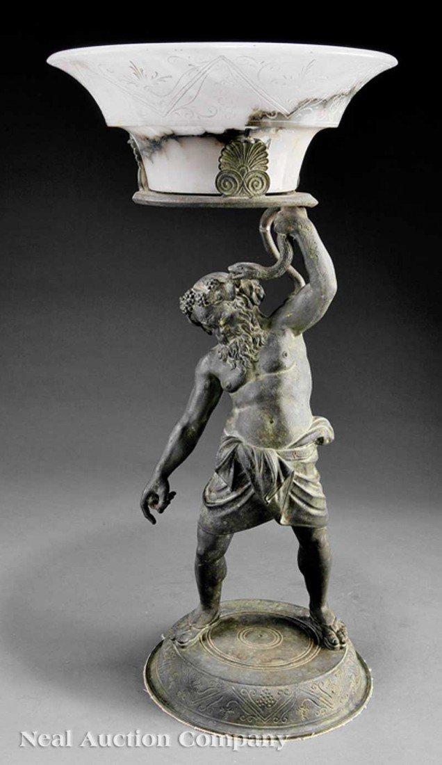 0016: An Italian Bronze of Silenus Holding Aloft a Serp