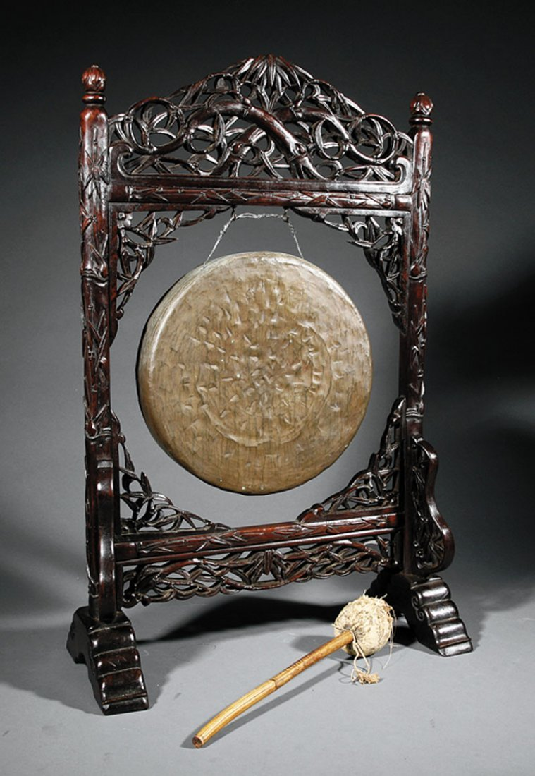 A Chinese Bronze Gong and Carved Hardwood Stand