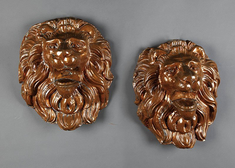 A Pair of American Repousse Copper Lion Heads