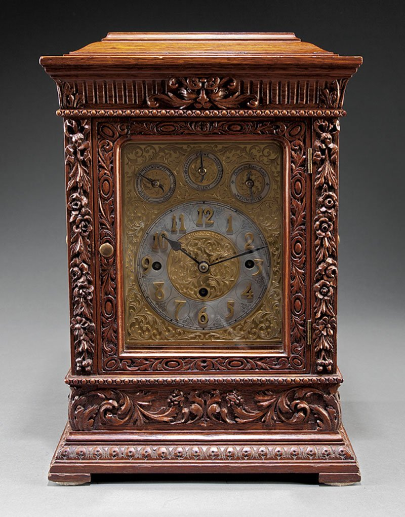 A American Carved Oak Eight Tube Chiming Clock