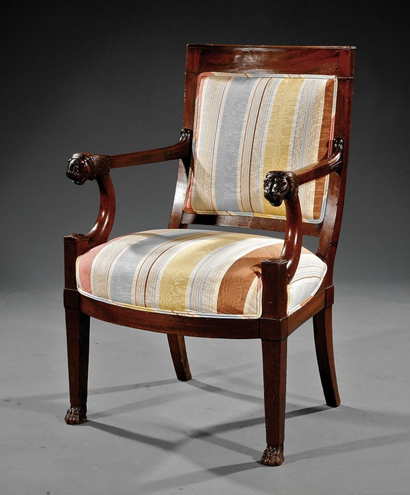 A Restauration Carved Mahogany Fauteuil