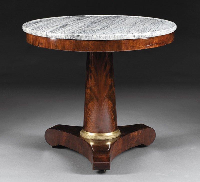 A Charles X Mahogany Center Table