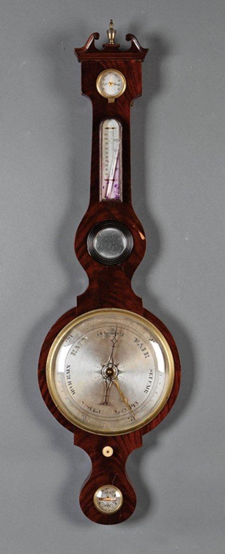 An English Carved Mahogany Barometer