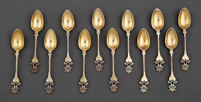 A Set of 12 Victorian Silver Gilt Teaspoons