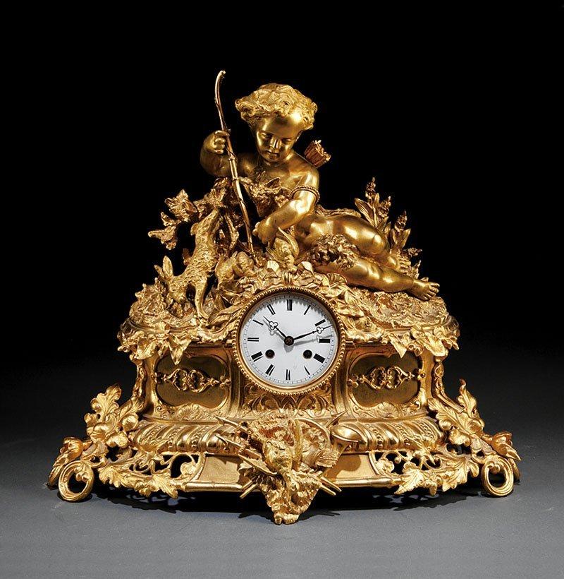 A Napoleon III Gilt-Bronze Mantel Clock