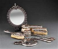 An Gorham Sterling Silver Repousse Dresser Set