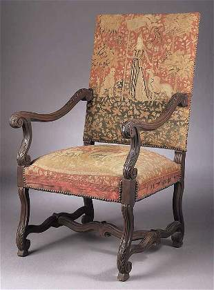 A Continental Carved Walnut Armchair i