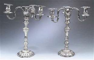 A Pair of Silverplate Three-Light Cand