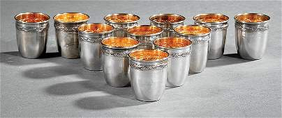 Twelve French First Standard Silver Shot Cups