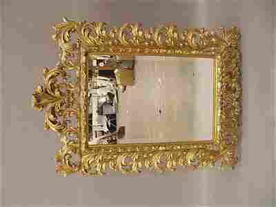 0355: A Giltwood Mirror , the beveled glass within bold